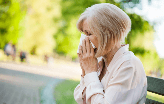 Woman experiencing nasal allergy symptoms during allergy season in Brevard County, FL